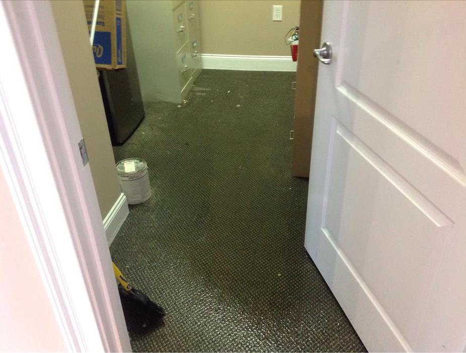 Water loss in an office building that affected carpet in a storage closet.