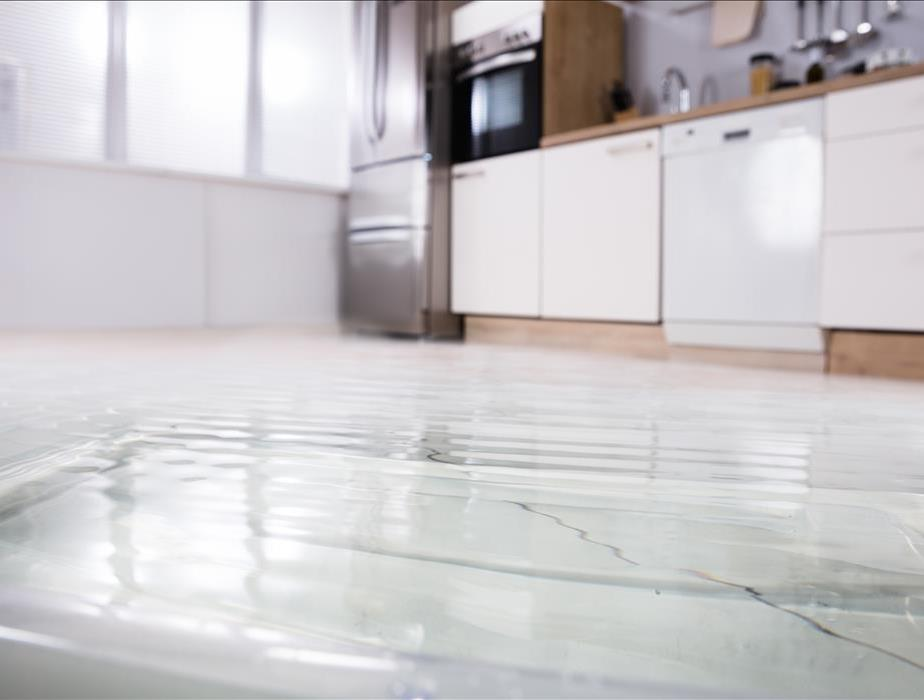Water covering a kitchen floor.