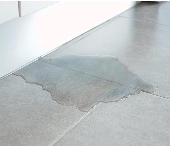 Water Damage to a tile floor.
